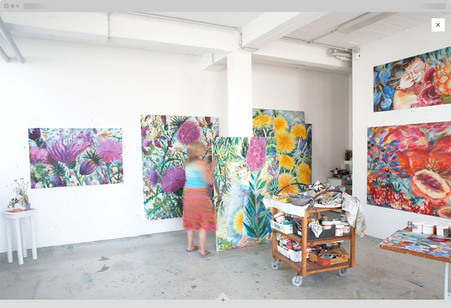 A fullscreen photo of Sabina in her studio