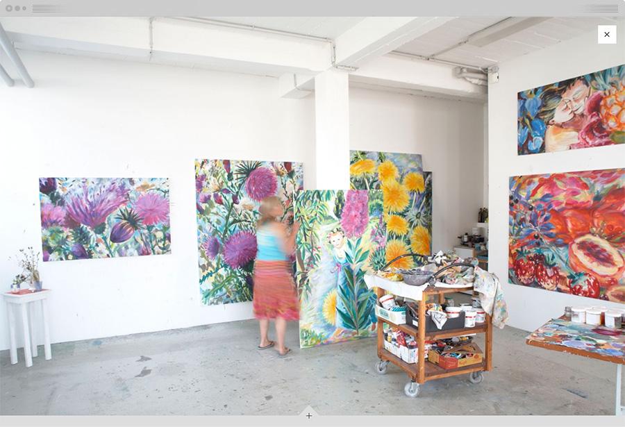 A fullscreen photo of Sabina in her studio